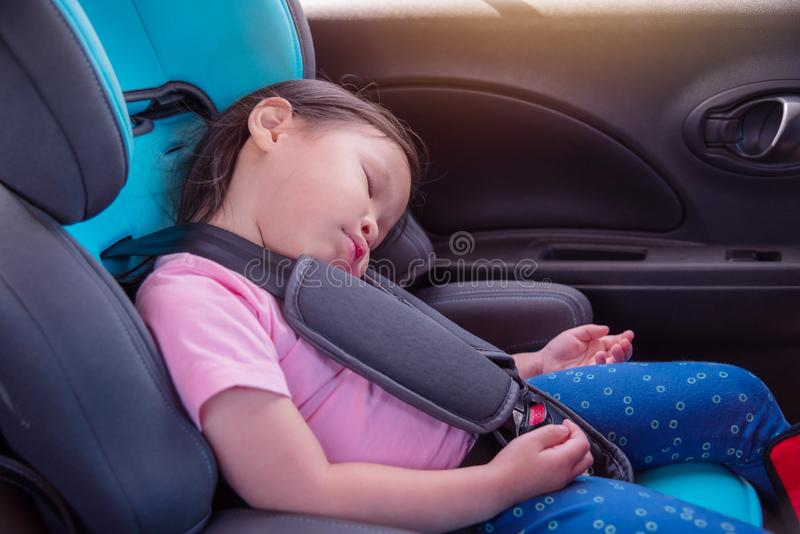 Girl sleeping on carseat in car stock photography