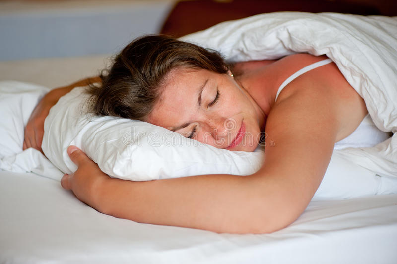 Girl sleeping in a comfortable position. On the stomach stock photography