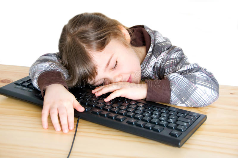 Girl is sleeping at the computer royalty free stock image