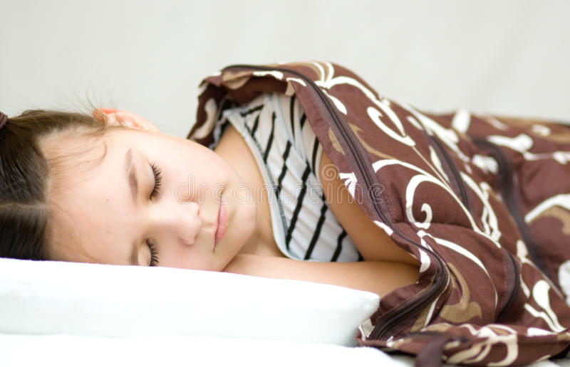 Girl is sleeping with her book and glasses stock photos