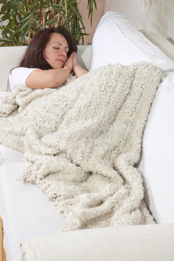 Girl sleeps on a soft divan royalty free stock photos