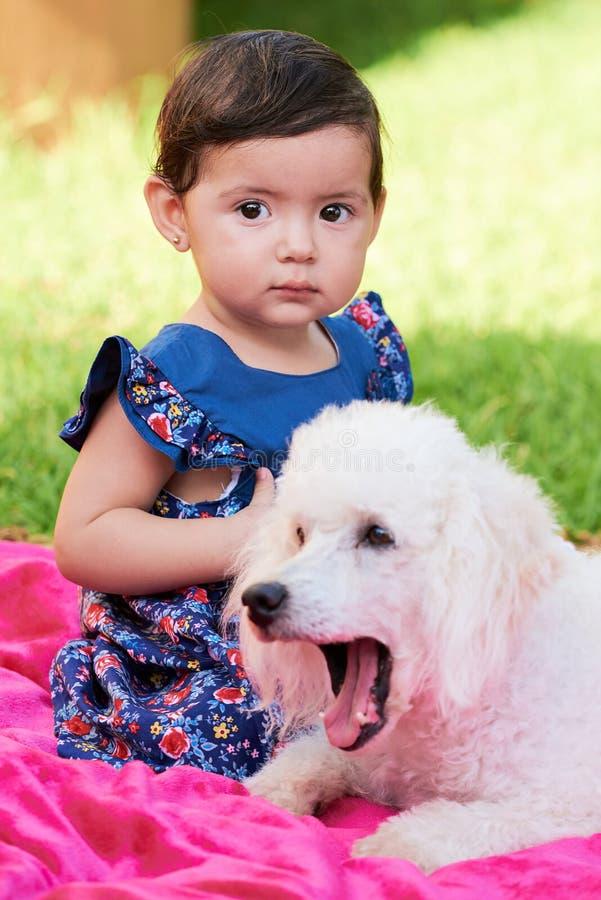 Girl with sleepy poodle stock image