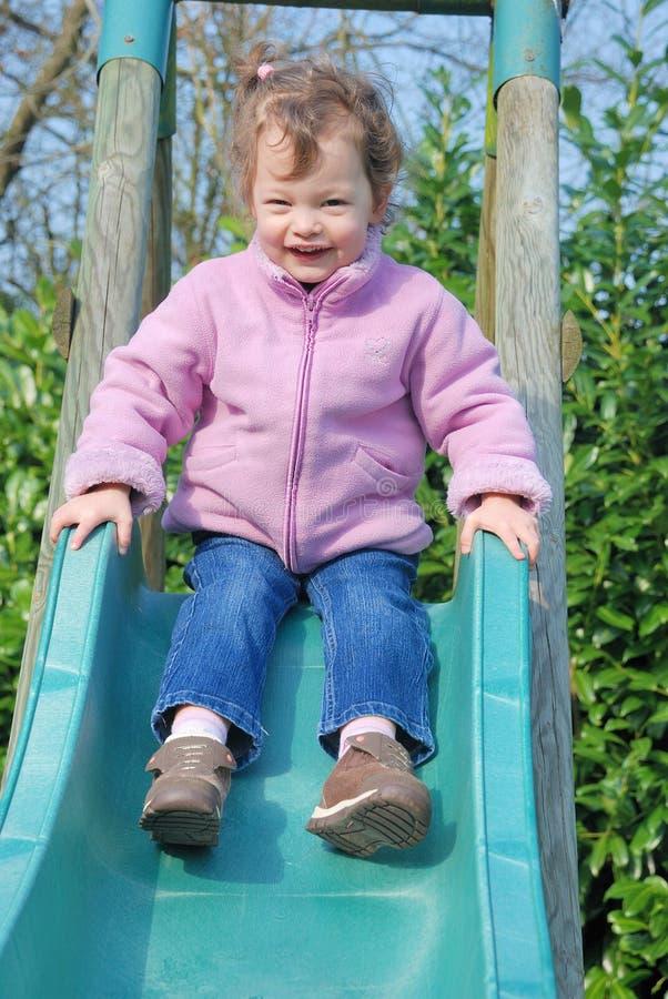 Download Girl on slide stock image. Image of toddler, playing - 19259105