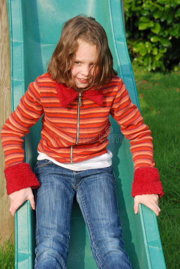 Download Girl on slide stock image. Image of play, slide, outdoor - 23074441