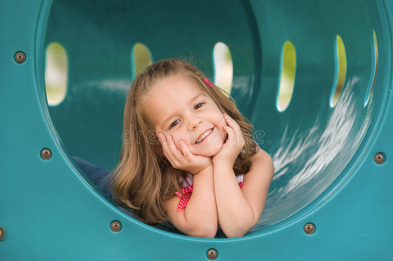 Girl on the Slide stock photos