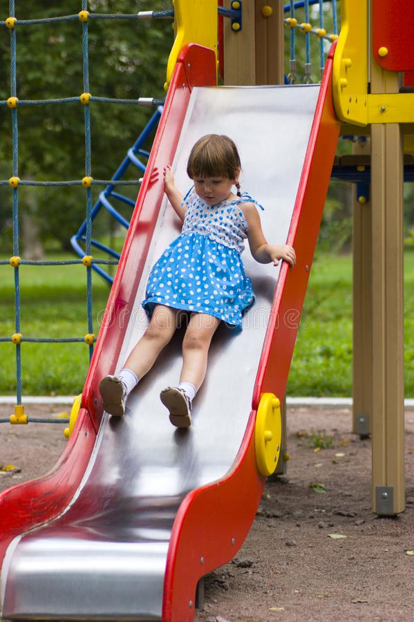 Download Girl sliding on playground stock image. Image of playful - 3089131