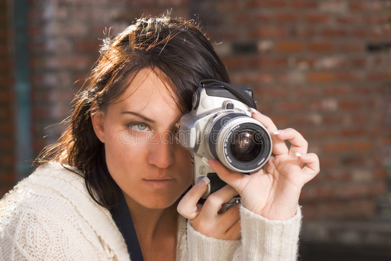 Girl with SLR photo camera stock images