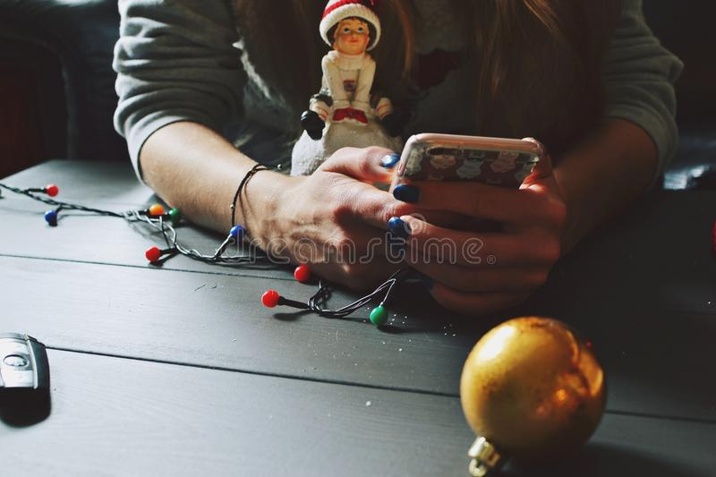 Download Girl With A Smartphone And Christmas Toys Stock Photo - Image: 83710379