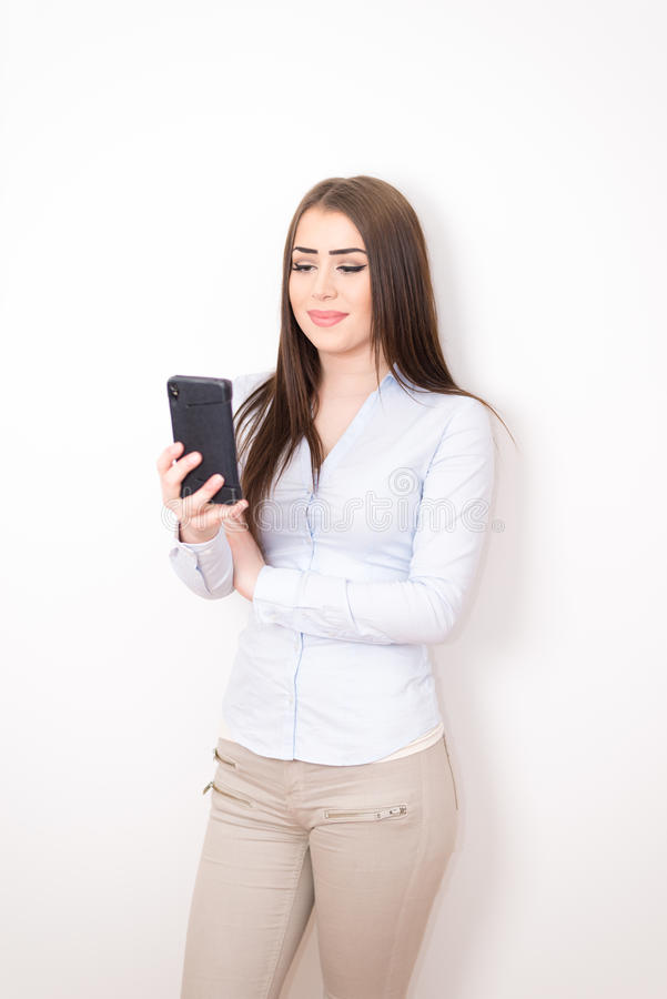 Business women with smartphone royalty free stock image