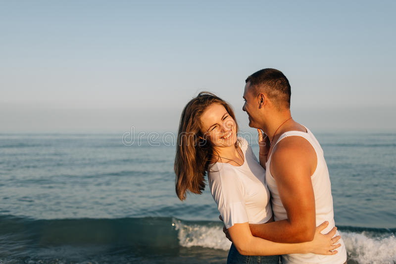 The girl smeetsya embracing the guy stock images