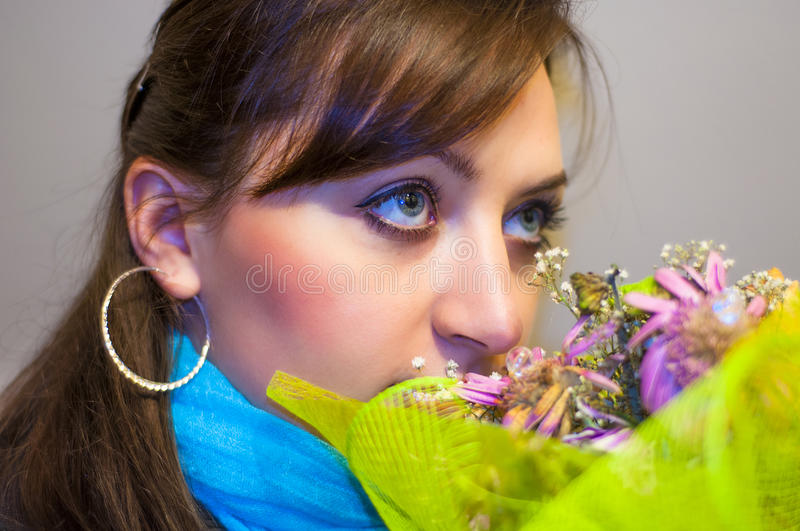 Girl smells bouqet. An image of girl smelling the bouqet stock photos