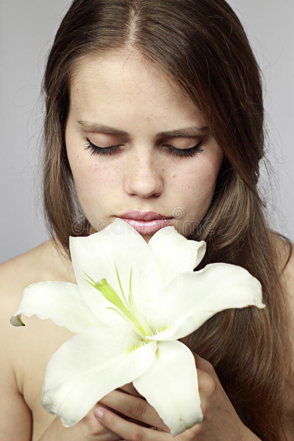 Girl smells a lily stock image