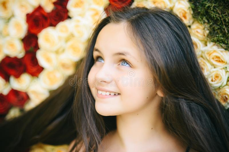 Girl smile with colorful roses, beauty royalty free stock image