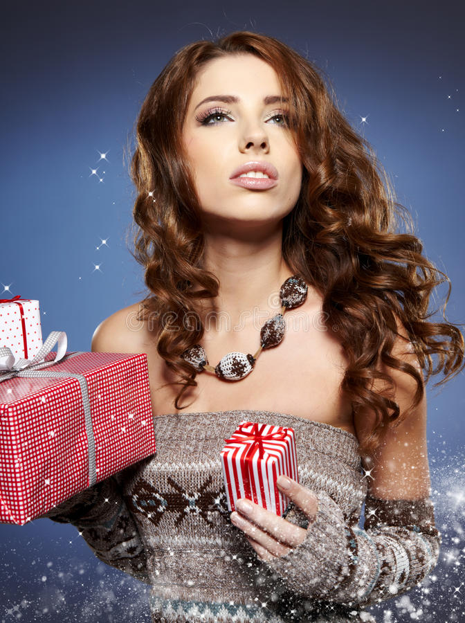 Download Girl Smiles And Holding A Gift Stock Photo - Image: 27887160