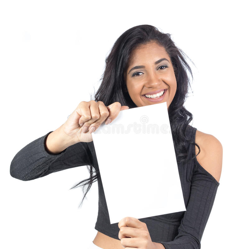 Girl smiles and shows white cartel. Female model wearing black c. Young Brazilian is presenting a plaque with offer and promotions. Advertising content. Afro stock images