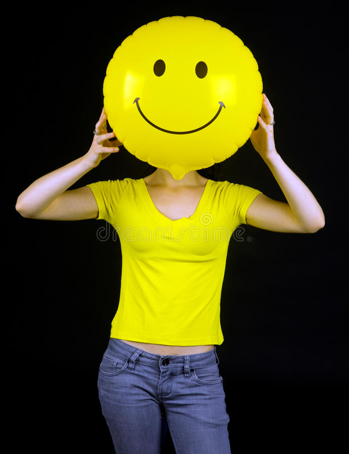 Download Girl With Smiley Balloon Instead Of Her Face Stock Photo - Image: 10052676