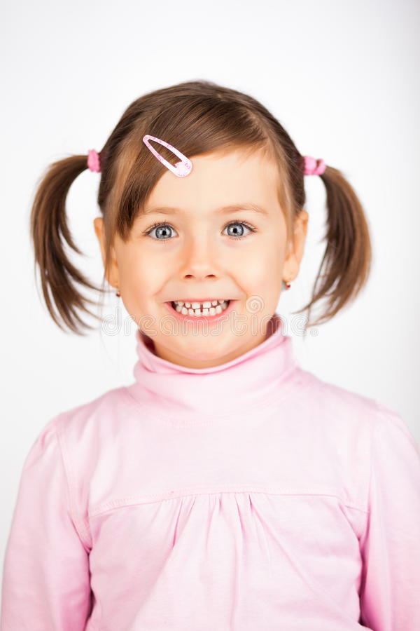 Girl smiling. Pretty little girl smiling royalty free stock photo