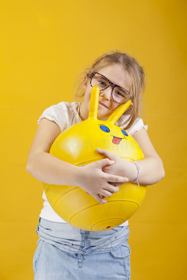 Download Girl With A Smiling Ball Royalty Free Stock Photo - Image: 28897945
