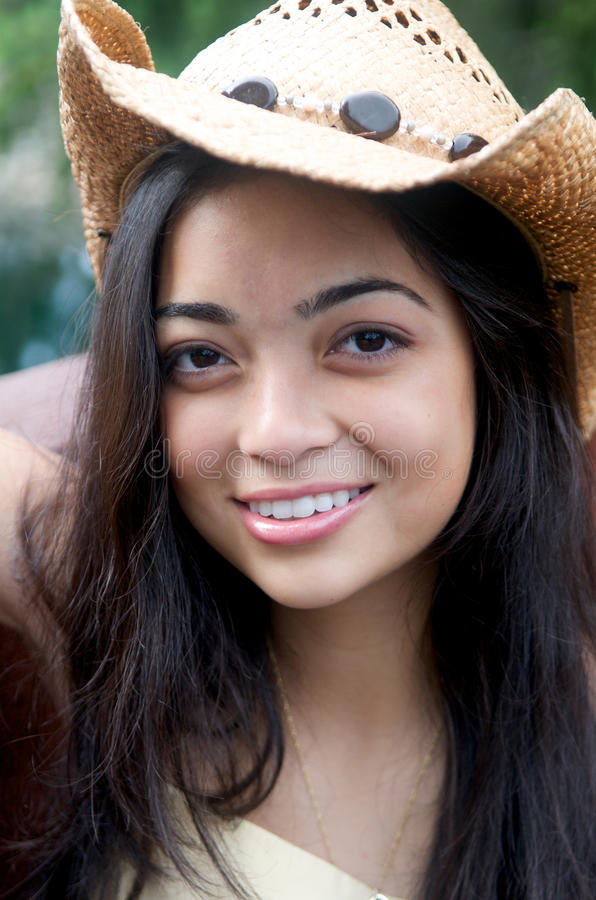 Download Girl Smiling In Cowboy Hat Stock Photography - Image: 20795332