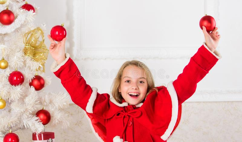Girl smiling face hold balls ornaments white interior background. Let kid decorate christmas tree. Favorite part stock image