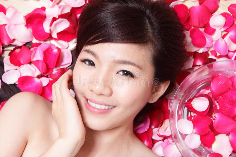 Girl Smiling Face With Rose Stock Images