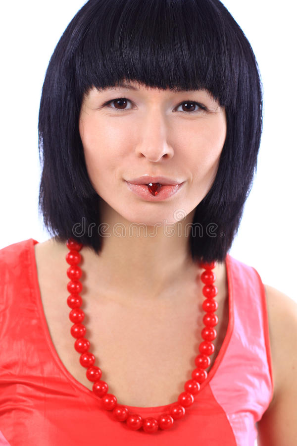 Download Girl Smiling And Holding A Little Heart In Her Lip Stock Image - Image: 22862973