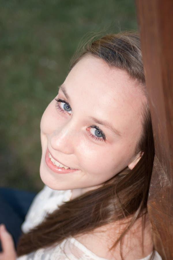 Download Girl Smiling Over Her Shoulder Stock Photo - Image: 36944312