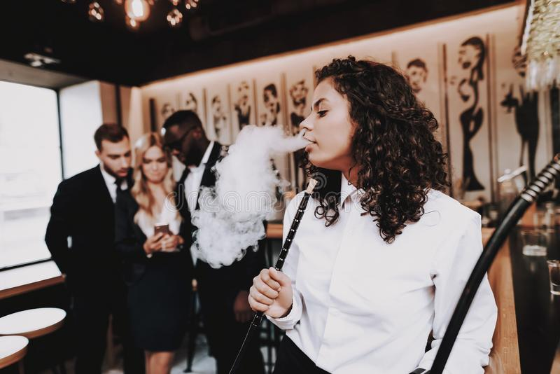 Girl Smoking. Hookah. Drink Alcoholic Beverages. Girl Smoking. Hookah. Drink Alcoholic Beverages Chin-chin Nightlife Beer Bar Rest Different Races Communicate royalty free stock photography