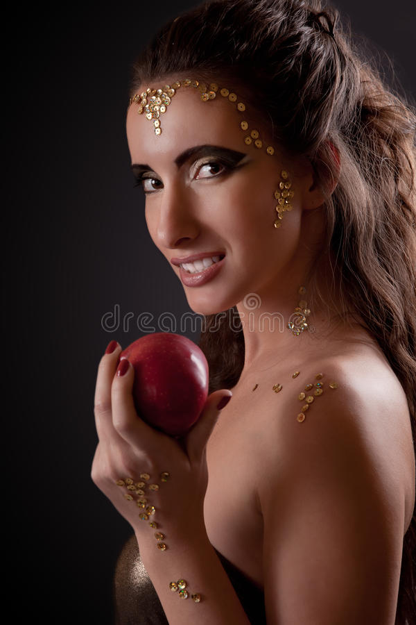 Girl in snake image with forbidden fruit stock image