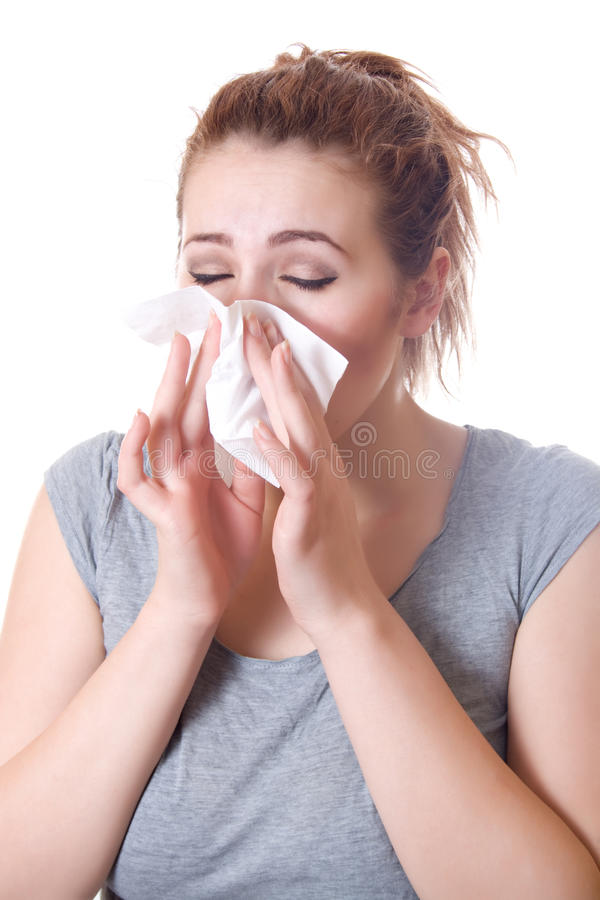 Girl sneezes stock photo