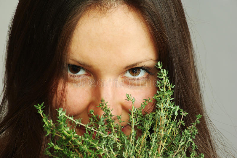 Girl sniffing thyme royalty free stock photos