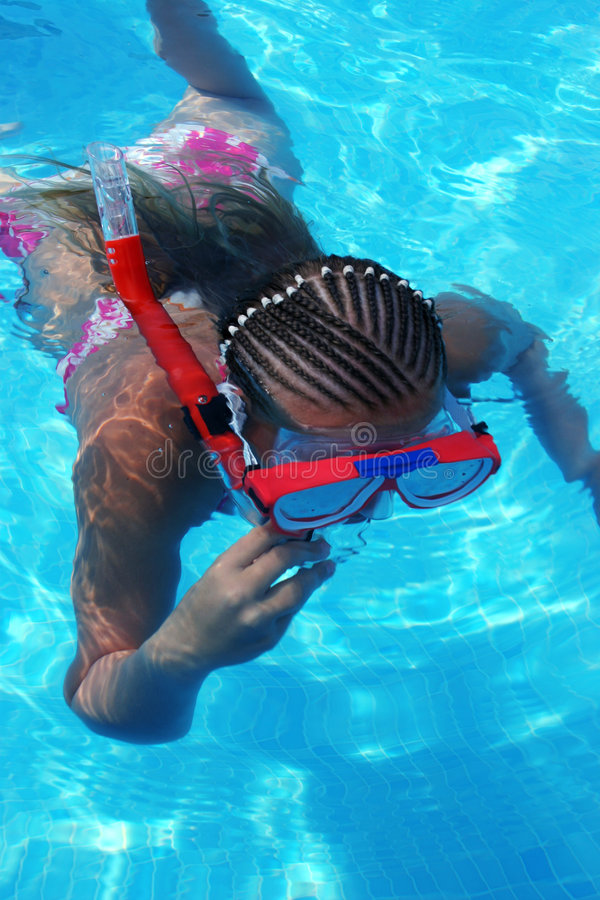 Girl snorkeling on a summer day royalty free stock image
