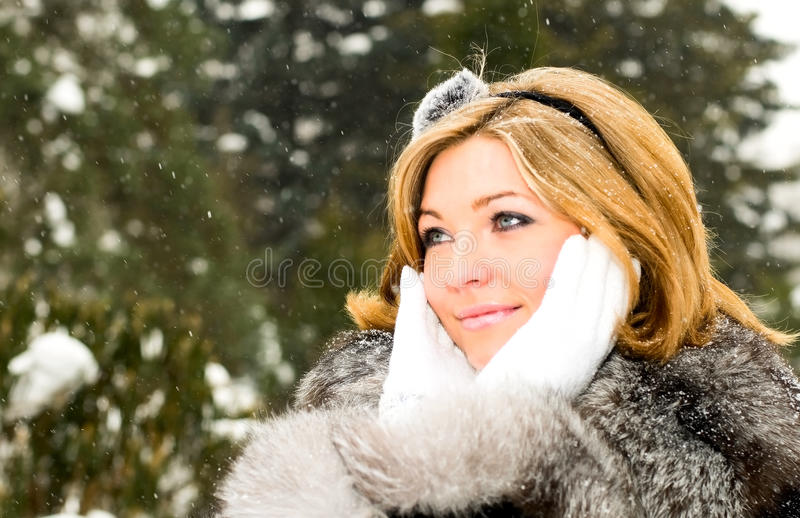 Girl and snow stock image