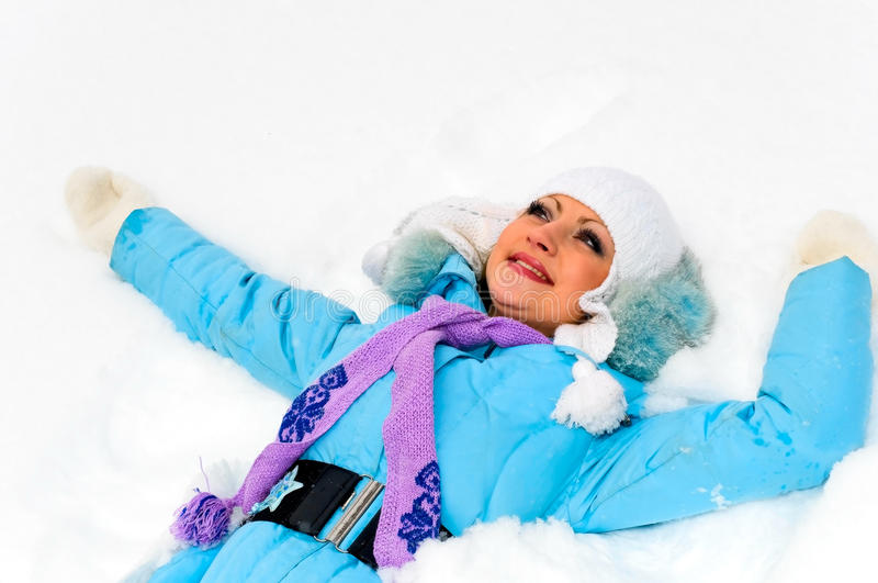 Girl on snow stock image