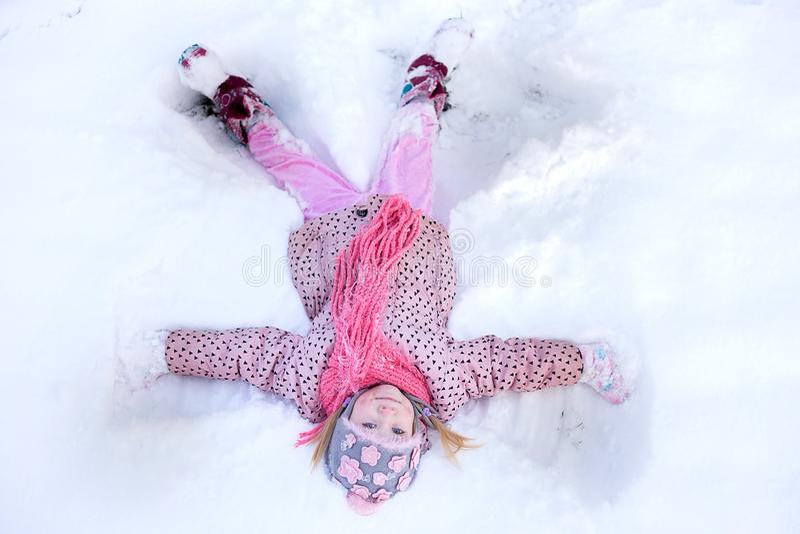Girl snow angel stock image