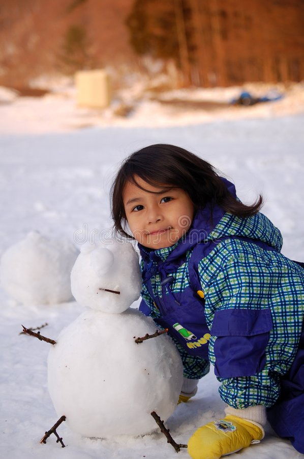 Girl And Snow Man Royalty Free Stock Photography