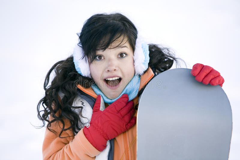 Girl with snowboard. Surprised Girl teenager with snowboard stock photos
