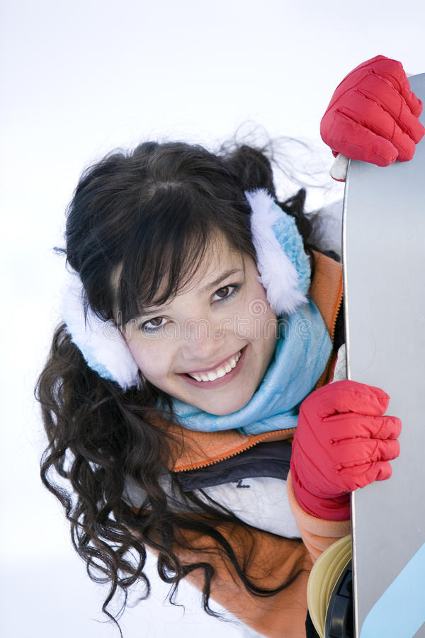 Girl with snowboard. Surprised teenager Girl with snowboard stock photo