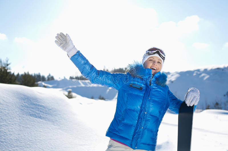 Girl with snowboard royalty free stock photo