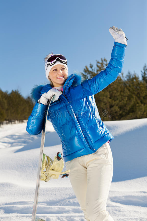 Girl with snowboard stock photography