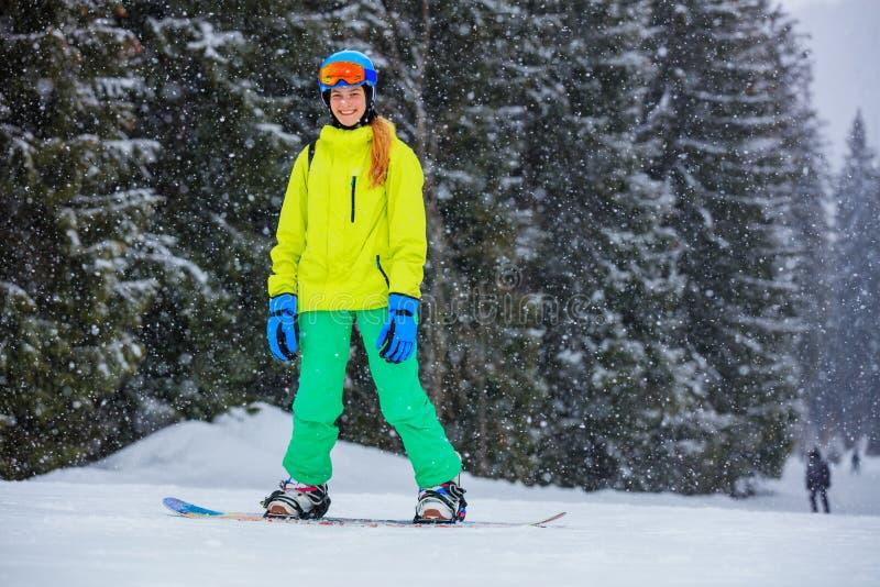 Girl snowboarder enjoys the winter ski resort. royalty free stock photos