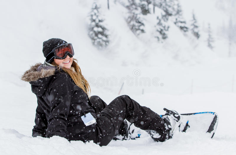 Girl snowboarding stock photo