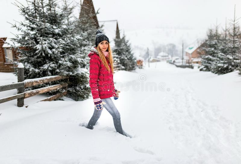 Girl snowdrift outside village or country, winter cold snow weather, woman in red jacket or clothes outdoor countryside stock images
