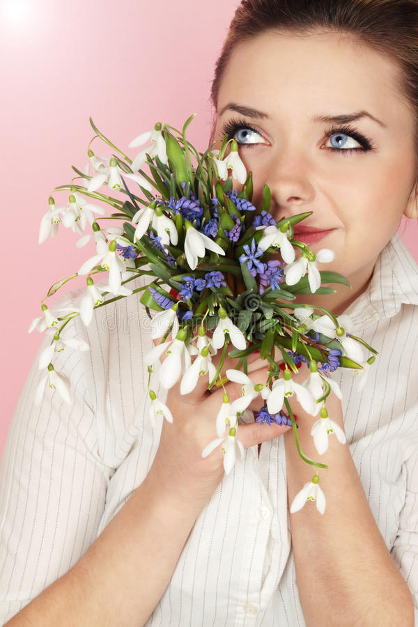 Girl and snowdrops royalty free stock photo