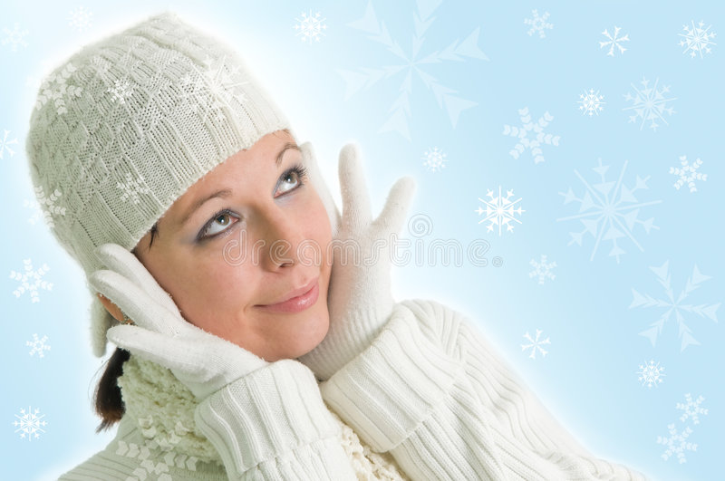 Girl with snowflakes. Attractive young girl with snowflakes in the background stock photography