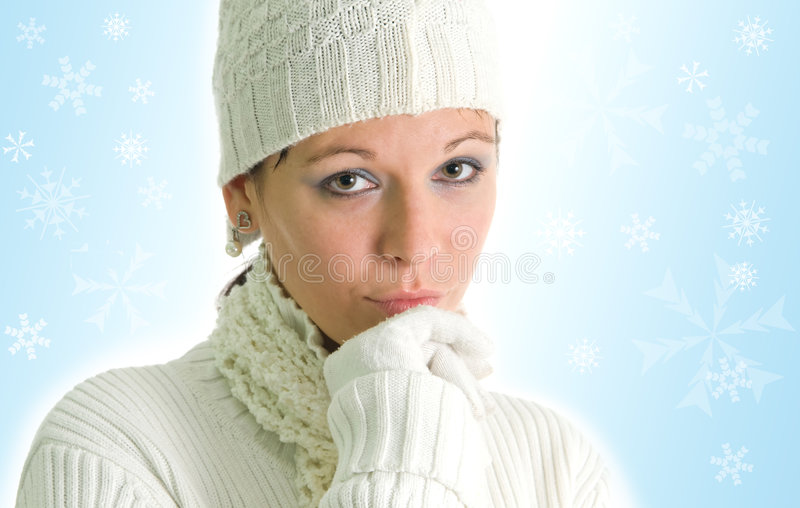 Girl with snowflakes. Attractive young girl with snowflakes in background royalty free stock photos