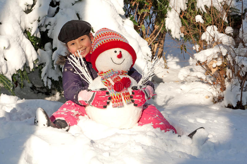 Download Girl with snowman stock image. Image of scarf, years - 17335125