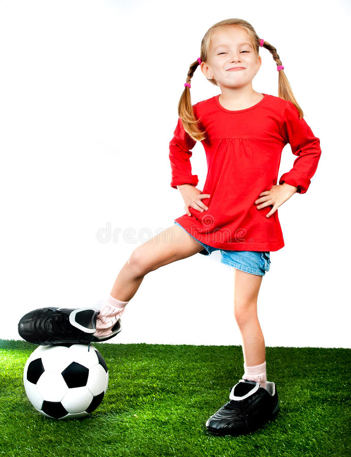 Girl with soccer ball in boots. On a green lawn royalty free stock photos