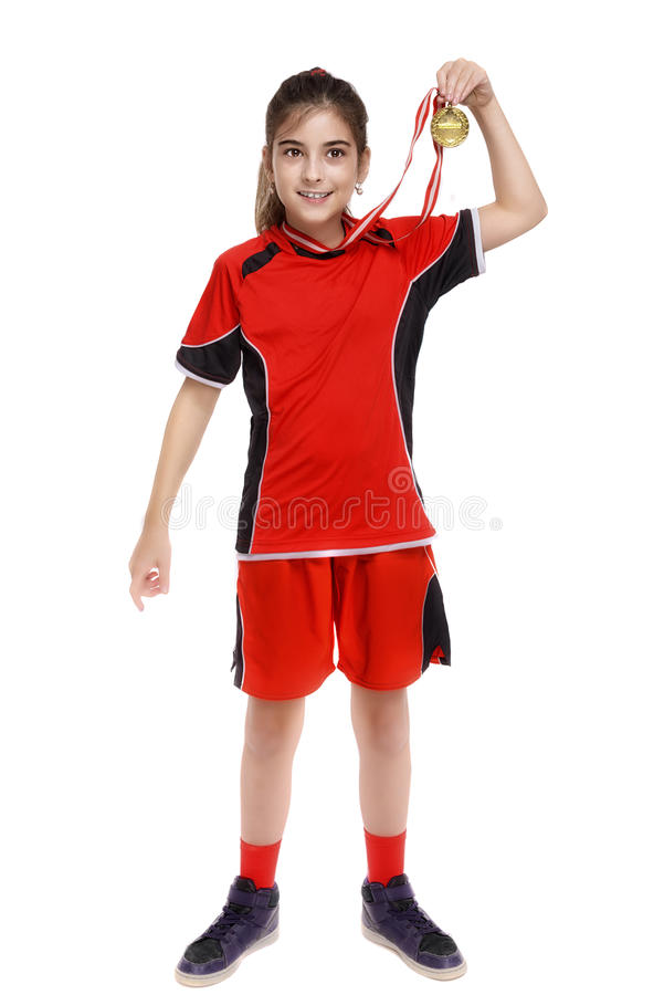 Girl soccer player shows gold medal stock images
