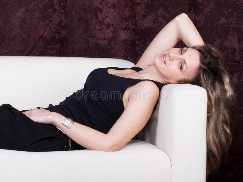 Download Girl on a sofa stock image. Image of beauty, woman, attractive - 24080511